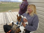 Renate with Biscuits and a crowd of dogs at her feet.